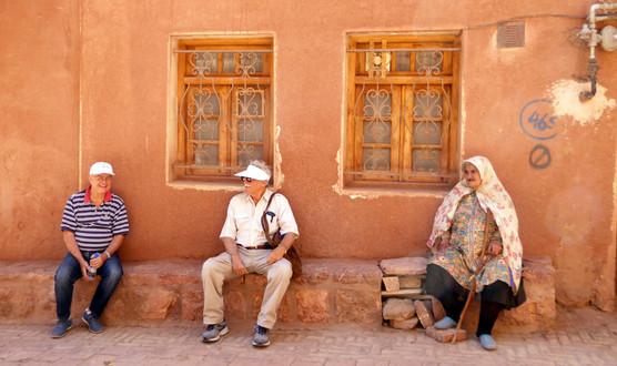 Tourists and Iranian woman, Abyaneh