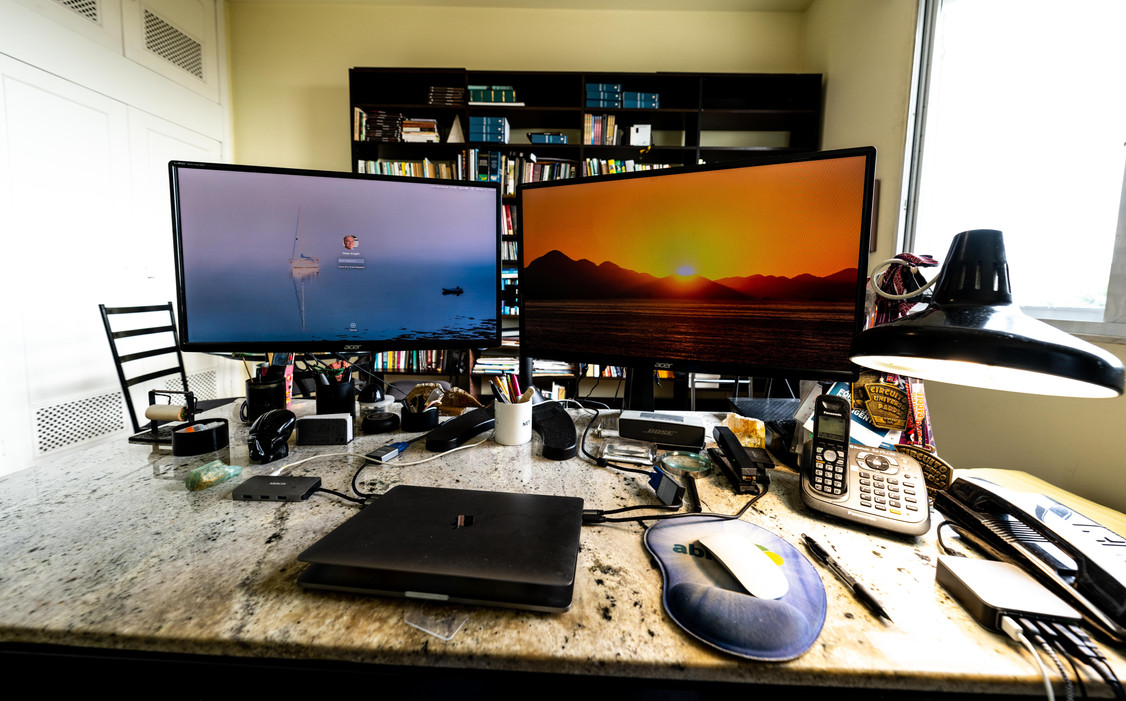Office desk with dual monitors on stand