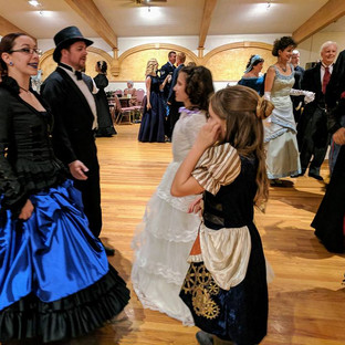 Adults dance with children of all ages