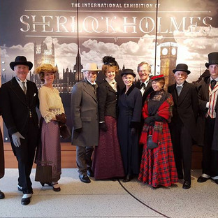 Sherlock Holmes Exhibit-Mike and Sharon Guli, Cody and Connor Cheadle posing with the public exhibit attendees in historic attire