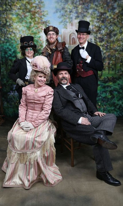 Victorian Ball dancers pose for a photo: Front: Suzy & Rick Ketchem. Back: Linda Huerta, Jesse Ogg and George Fischer