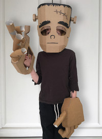 Cardboard Frankenstein costume with large robotic hands