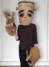 Cardboard Frankenstein costume with large robotic hands