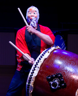A member of the Japanese drum group Taikoza, performs in a mask at the Chautauqua Institution Tuesday, August 6, 2019