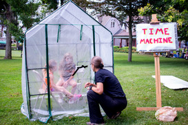 Artist Eliza Evans creates an experiential art piece, 'Time Machine', to encourage people to use their body as a sensing instrument to feel the impact of climate change. Here, she asks four-year old Sienna Madden, left, and seven-year old Kyle Madden about their experience of being inside the Time Machine. Sunday, August 4, 2019 at the Chautauqua Institution.