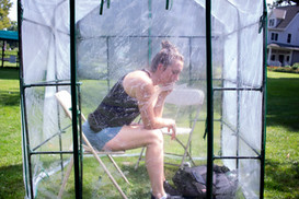 Victoria DuBon, an environmentalist, sets a timer for five minutes inside the 'Time Machine' Sunday, August 4, 2019