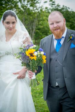 groom carrying flowers