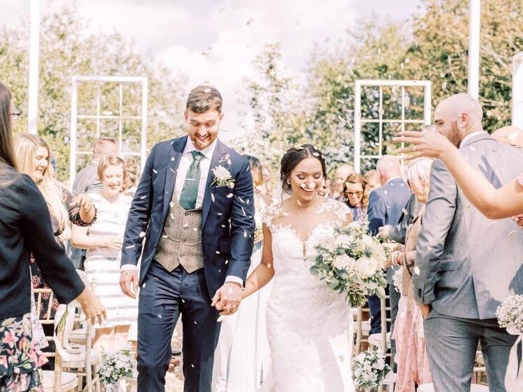 outdoor wedding ceremony at alcumlow wedding barn