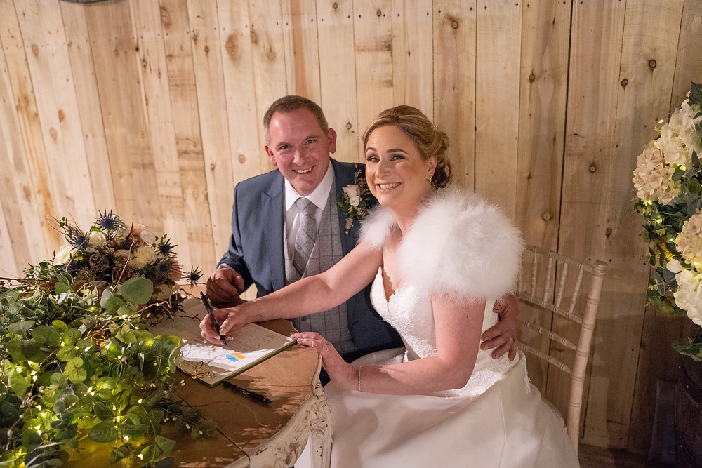Signing the register after an outdoor wedding ceremony at alcumlow