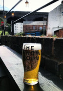 Cold pint by the River Rea