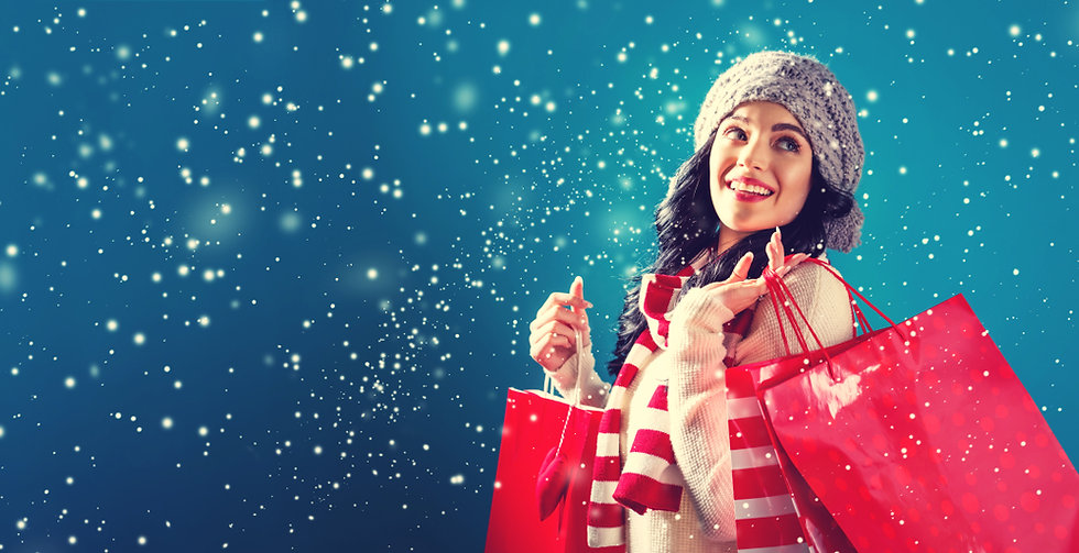 Woman carrying shopping in a Snow scene