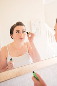 Checking her make up