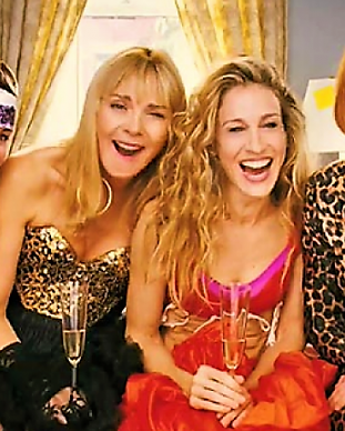 sex-and-the-city-cast-on-bed-laughing-on