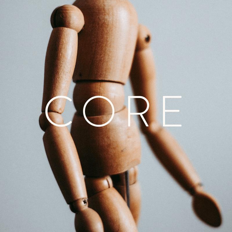 Foto einer Figur aus Holz.
