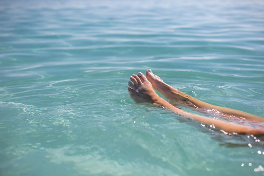 feet-floating-in-blue-water.jpg