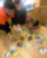 Three siblings learning through play using Teddö Play learning cards