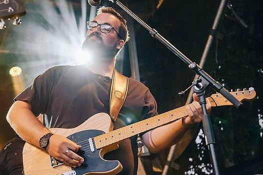 Arun O'Connor Gold Guitar winner performing at Top Padock Music Festival New Years Eve Lake Wanaka