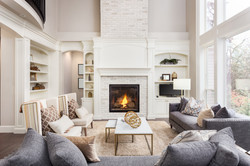 Beautiful living room interior with hardwood floors and fireplace in new luxury home.jpg