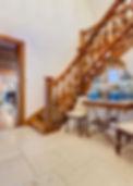 Jennie Schmid Design, Interior Design, Designer, Switzerland, Lausanne, Villa, Portfolio, Antique table de Boucher from Provence, antique gilded mirror from France, antique urn from Provence, shells from California,embroidered silk pillows,Selection of blue and white china
