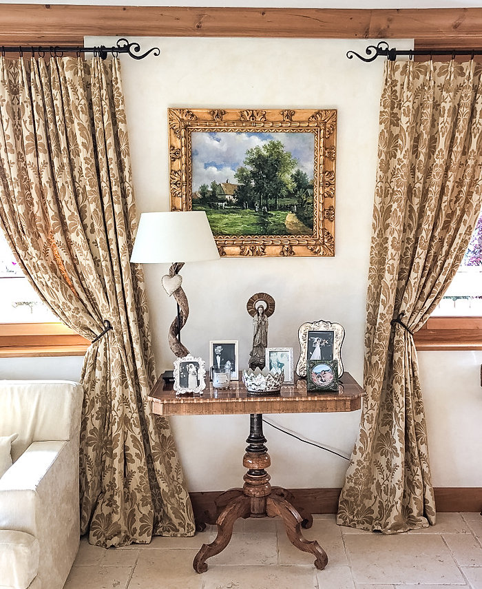 Jennie Schmid Design, Interior Design, Designer, Switzerland, Crans Montana, Chalet Montesano, Swiss Alps, Portfolio, Ski Resort, Antique table from France, antique mother of Mary statue from Italy, Horn and iron lamp, antique painting from Provence
