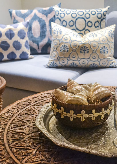 Jennie Schmid Design, Interior Design, Designer, Switzerland, Lausanne, Villa, Portfolio, entertainment room, home cinema, tv room, games room, Moroccan carved table,silver Moroccan tray,Indonesian basket with shells,African drum table,selection of ikat and suzani pillows from Turkey
