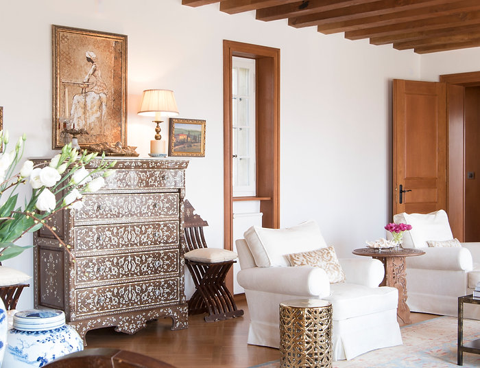 Jennie Schmid Design, Interior Design, Designer, Switzerland, Lausanne, Villa, Portfolio, Syrian chest with mother of pearl inlay,Syrian chairs with mother of pearl inlay,antique brass lamp with silk shade, painting by peter Elungat