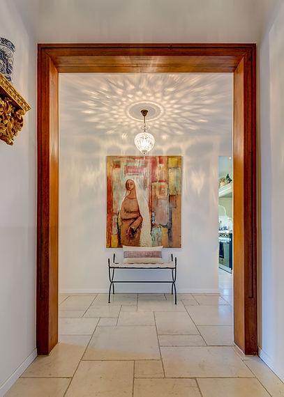 Jennie Schmid Design, Interior Design, Designer, Switzerland, Lausanne, Villa, Portfolio, entryway, hallway, Gilded sconce from France, Chinese White vase