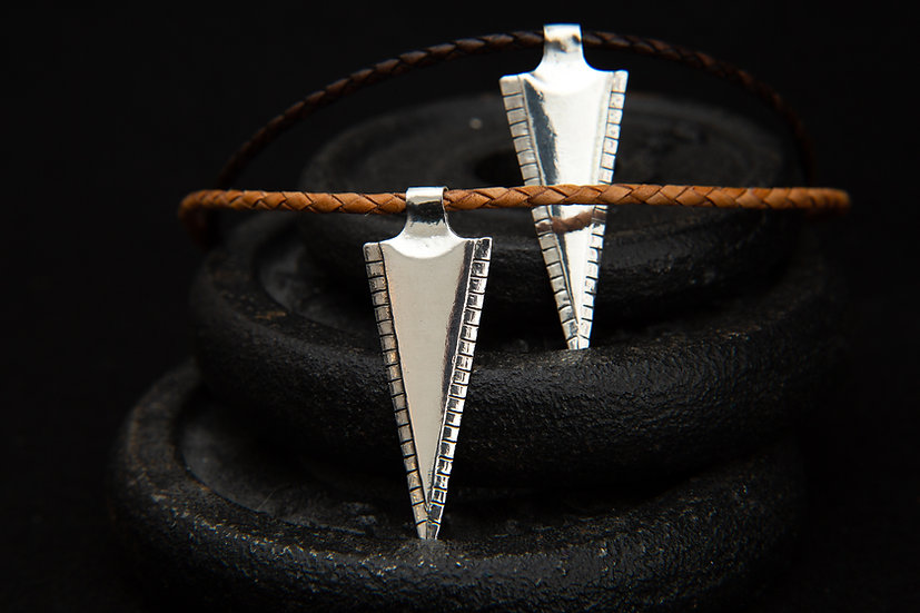 Hama - Tribal arrow pendant on braided leather. 925 sterling silver spearhead