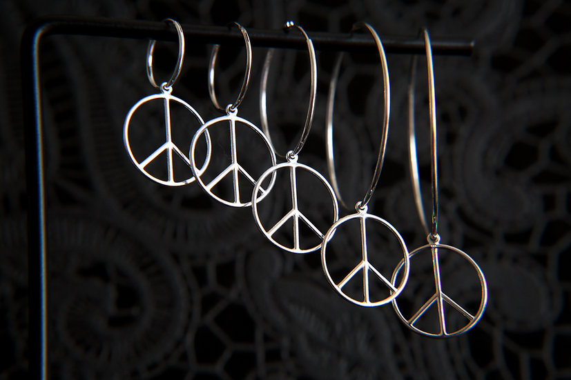 Sterling silver Peace Sign Symbol hoop earrings with a variety of hoop sizes.