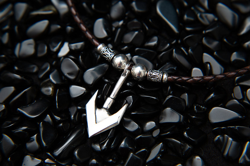 Archiba, Double sided tribal silver arrow pendant on brown braided leather