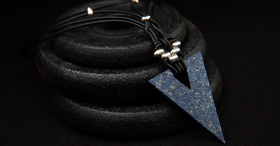 Molax Chopa tribe Zenith leather choker with lapis lazuli arrow pendant.