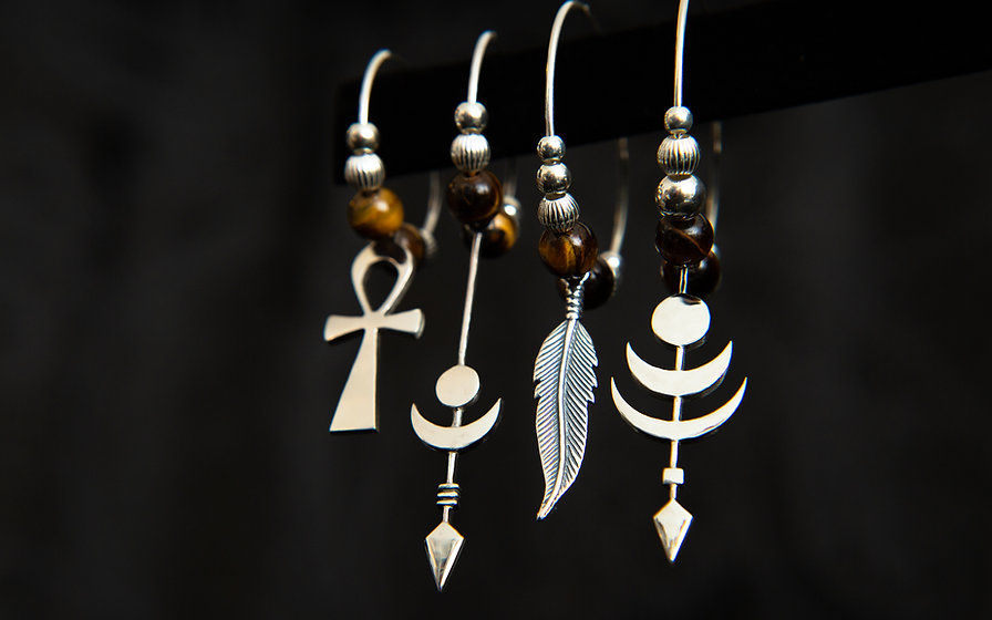 chopa tribe mis matched tribal silver earrings with tiger eye gemstones. By silversmith molax Chopa, london