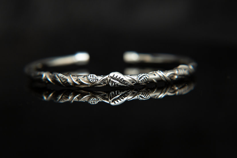 The Heka, Leaf and Vine sterling silver solid bangle. Nature Ivy Bangle.