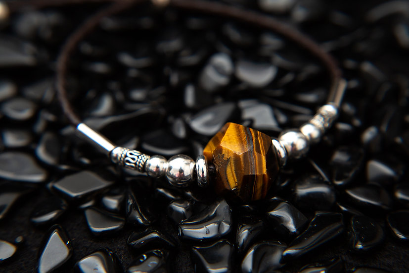 Tiger eye braided leather and sterling silver adjustable bracelet.