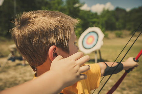 A scout doing archery.