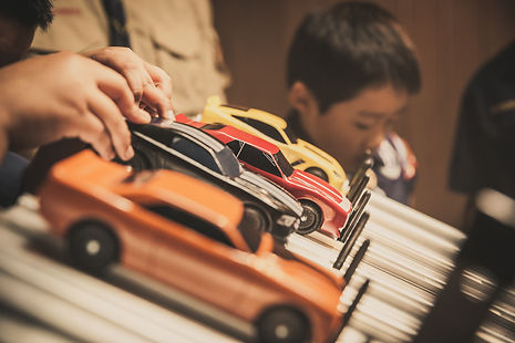 Pinewood Derby (PWD) cars lined up for a race.