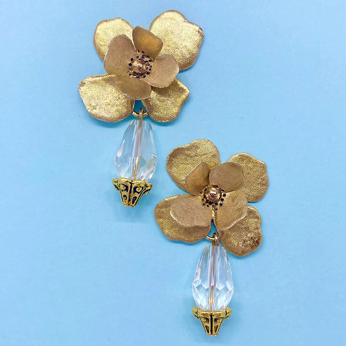 Gold colored flower statement earrings