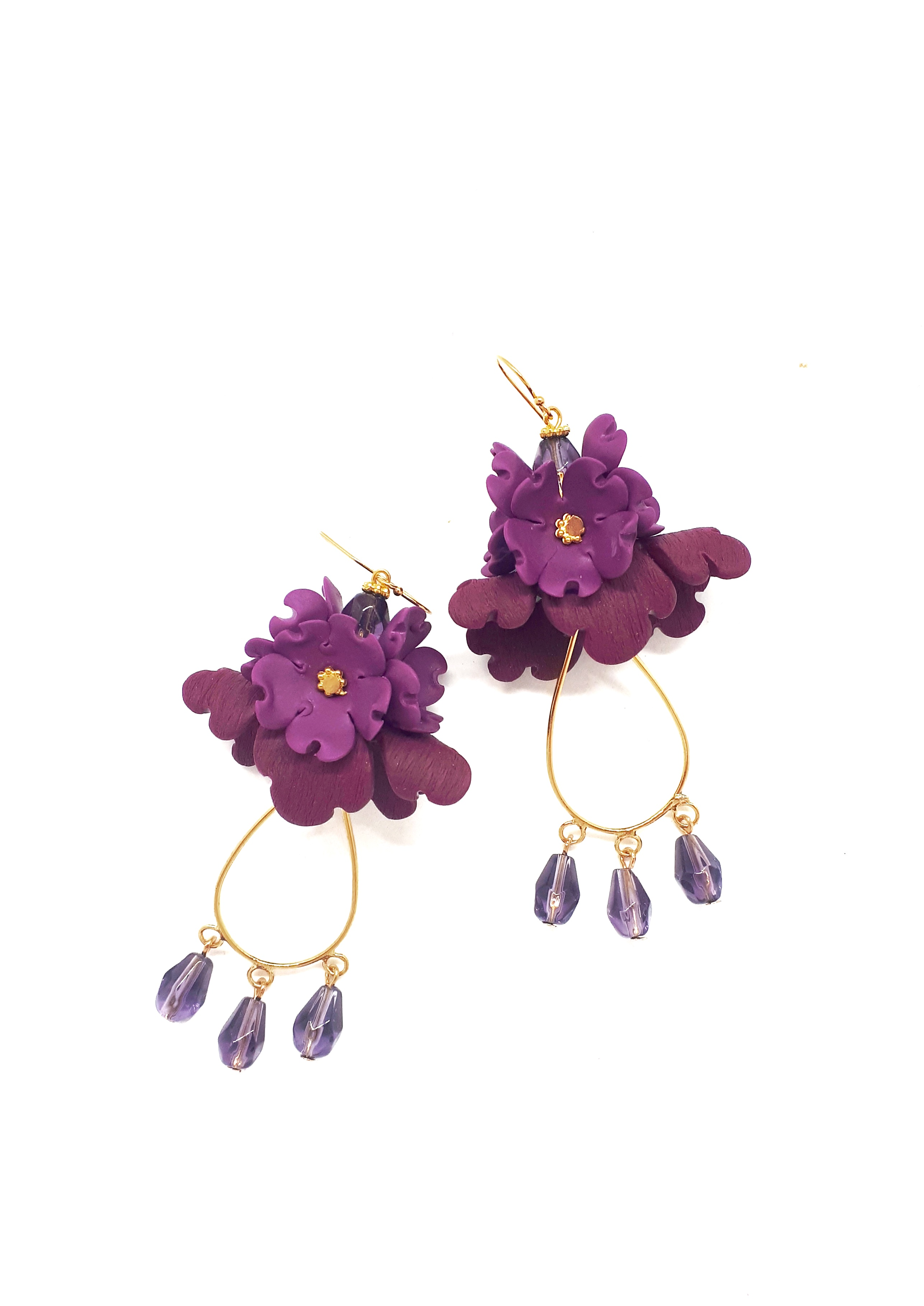 Small folded flower earrings; gold hardw