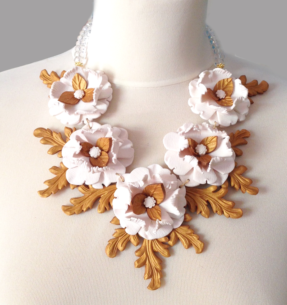 White flowers, golden frame necklace