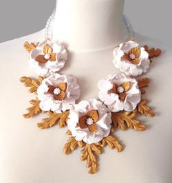 White flowers, golden frame necklace