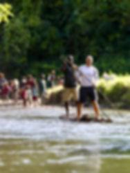 Man on raft paddling