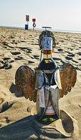 wine bottle in sand.jpg