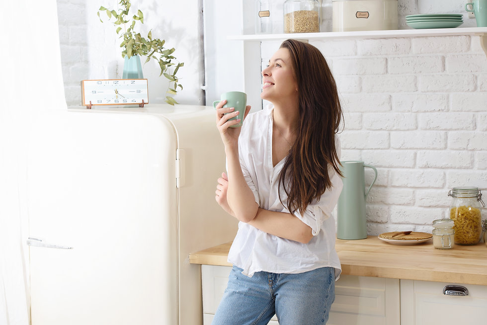 Young happy woman drinking coffee on the