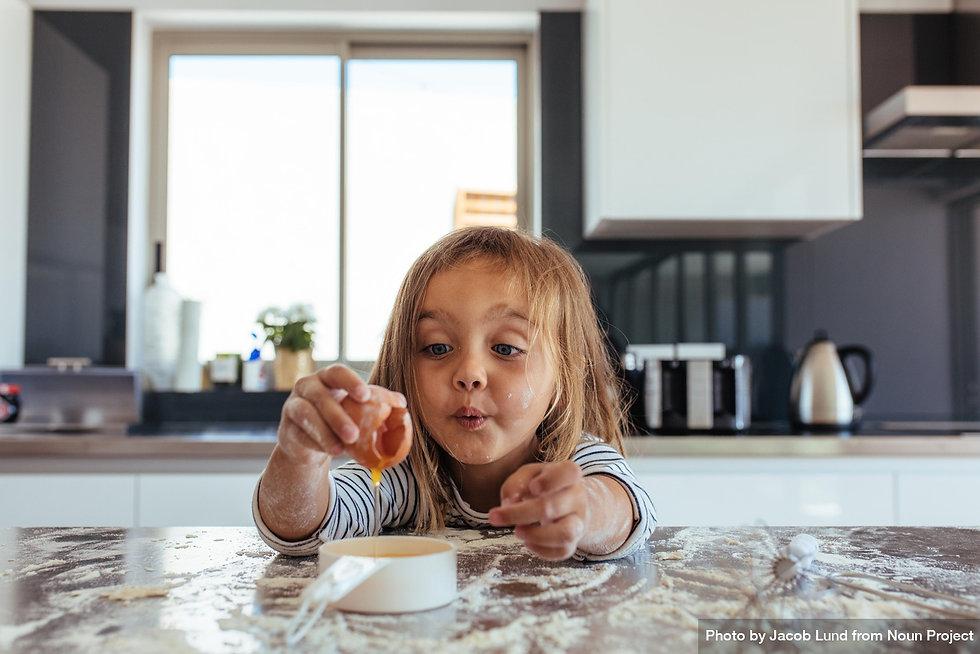 little girl breaking an egg.jpg