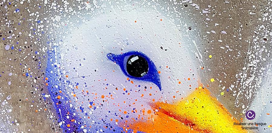 Peinture d'un oeil de cigogne avec des éclaboussures, du parc Argonne Découverte, par Cynthia Dormeyer