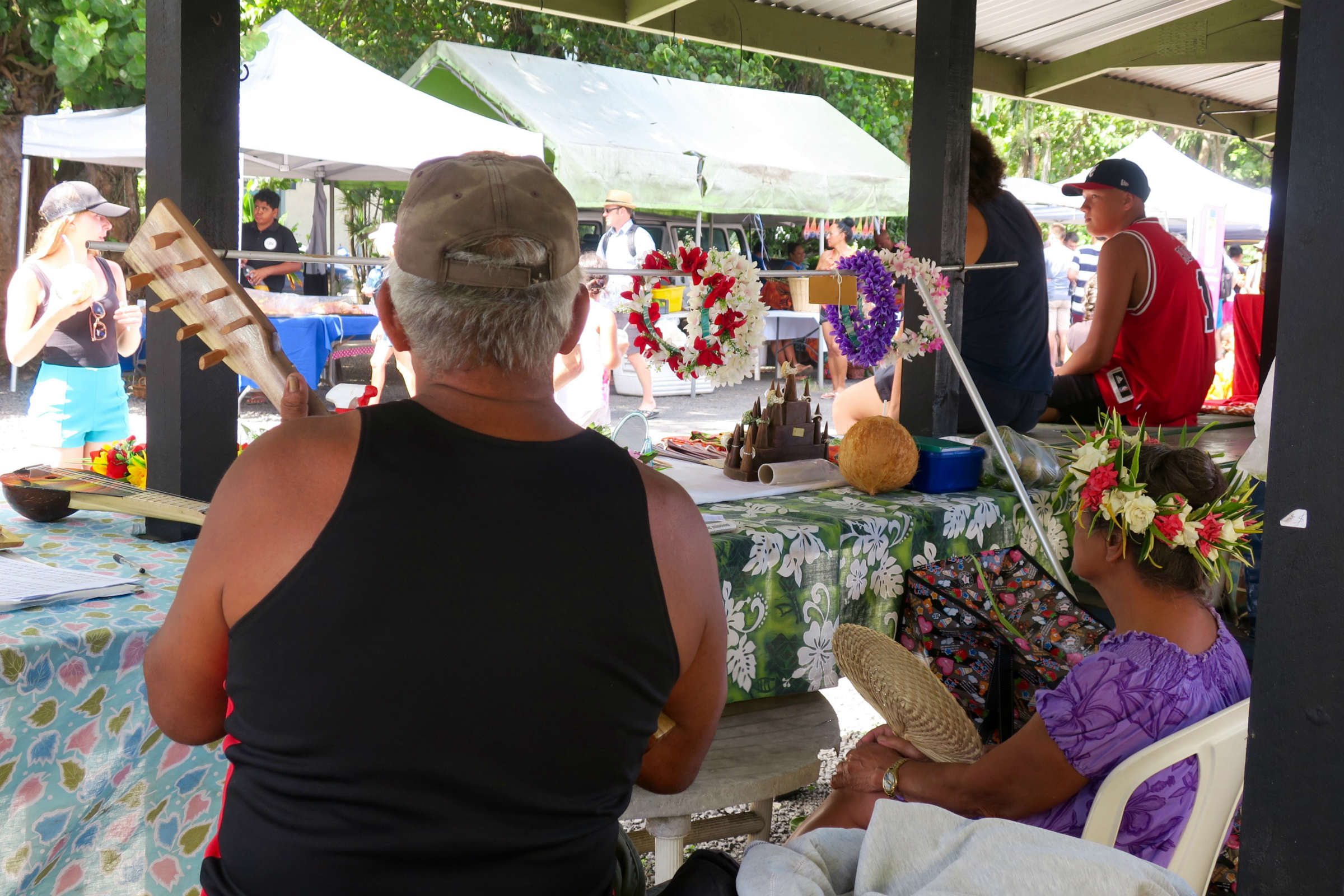 elderly couple in market stall