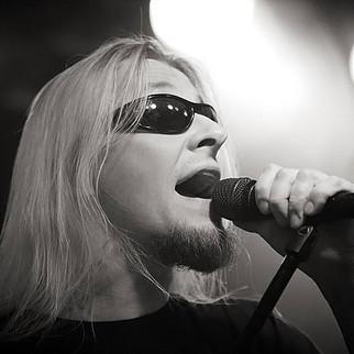 Mikko Herranen singing into a mic