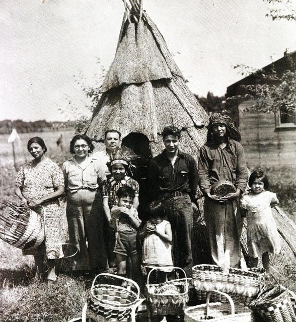 Potawatomi citizens with baskets, circa 1930 near Seven Mile in Dowagiac