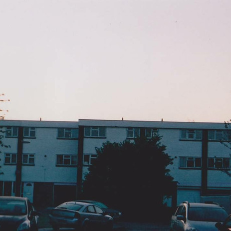 suburban town s t r e t c h ing - a poem by lyds