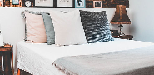Rustic%20Bed%20with%20Pillows_edited.jpg